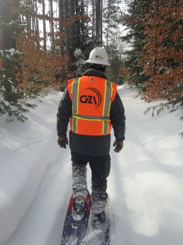 A GZA employee snowshoeing